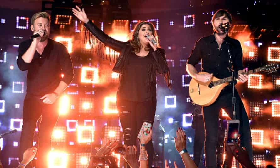 Charles Kelley, Hillary Scott, and Dave Haywood of Lady Antebellum play the ACM awards.