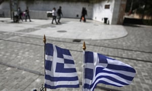 Greek flags flutter in an Athens street as the  government remains locked in strained negotiations with creditors.