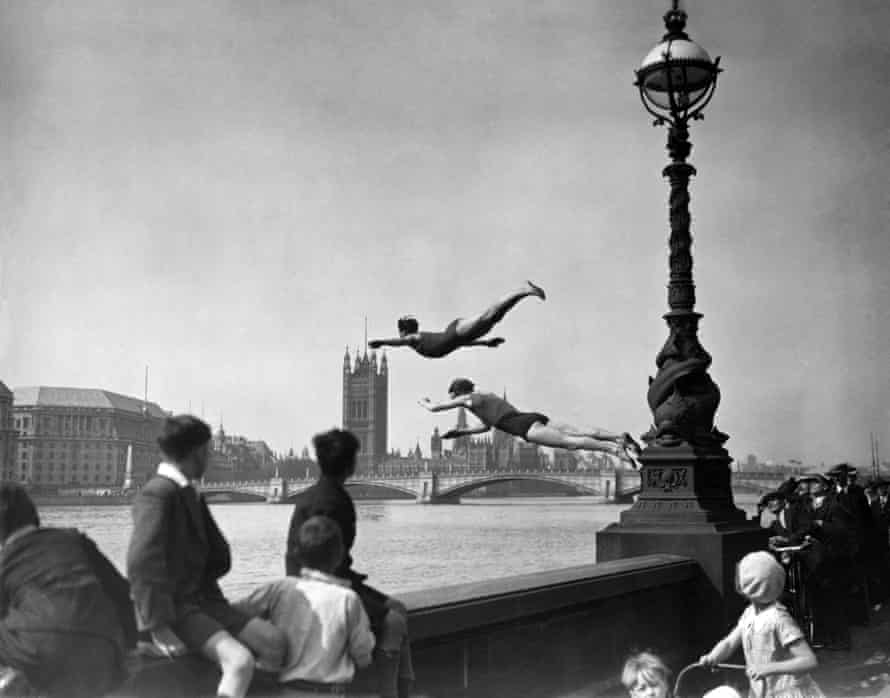 Two divers jumping off the Embankment into the River Thames in London, near Westminster bridge, July 1934.