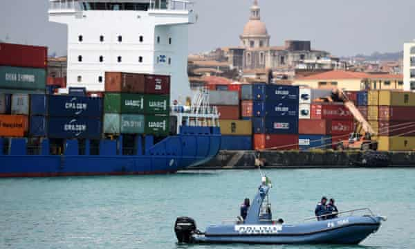 Police at Catania await the arrival of 27 migrants who survived the shipwreck.