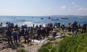 The rescue operation on Rhodes after a vessel carrying migrants ran aground on Monday.
