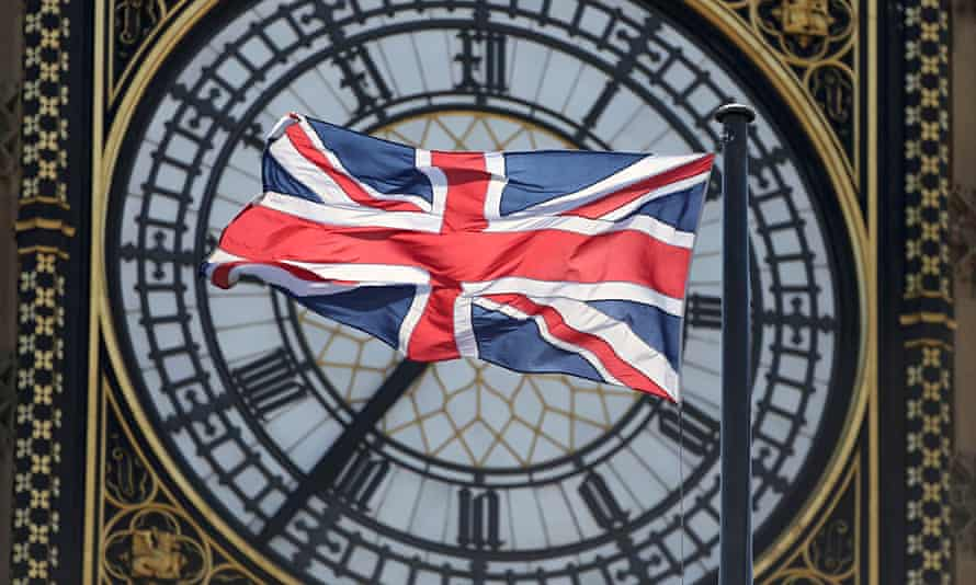 The Union Flag flutters in front of the Big Ben clock tower on the Houses of Parliament in London