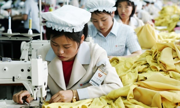 North Korean women wearing white hats work at sewing machines at the assembly line of a textile company  at the Kaesong industrial complex  in North Korea.