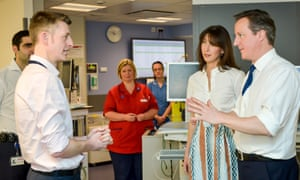David and Samantha Cameron talk to David Shackley, clinical director of urology, during a visit to the Salford Royal hospital in Manchester.