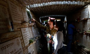 An Israeli soldier lays flowers on the memorial wall at Jerusalem's Mount Herzl military cemetery.