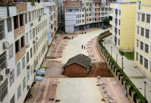 A nail house sits in the middle of a road under construction in Nanning