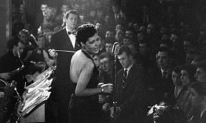 Billie Holiday in the spotlight during a performance.