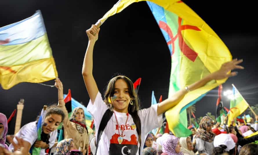 A girl waves an Amazigh flag at a rally in September 2011 in Tripoli calling for the recognition of the Amazigh language and culture.