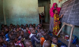 Students from different ethnic groups attend a class together at a school in Gao, Mali,