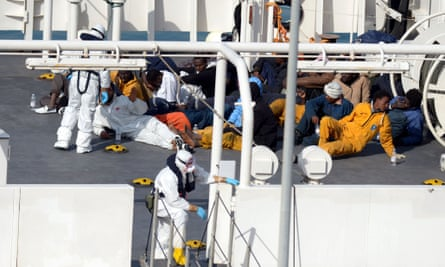 Survivors of an accident in which a fishing boat carrying migrants capsized off the Libyan coast, sit on the deck of the Italian Coast Guard vessel Bruno Gregoretti at Boiler Wharf, Senglea in Malta on April 20, 2015. More than 700 people are feared dead following the capsize off Libya of a fishing boat that had been crammed with migrants trying to reach Europe.
