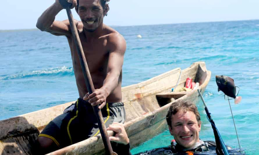 Will Millard with Kabei during a spear fishing expedition in the waters around Sampela village, Sulawesi.