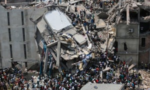 People rescue garment workers trapped under rubble at the Rana Plaza building.