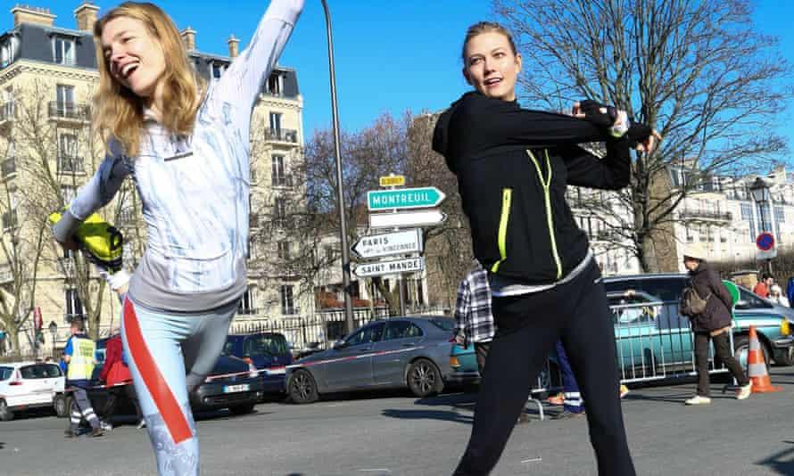 Natalia Vodianova and Karlie Kloss get ready to run the Paris half-marathon.