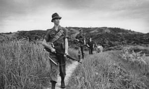 Scots Guards patrol an area of jungle in Malaya in 1950. British troops were there to fight communist insurgents of the Malayan National Liberation Army in what was then a UK protectorate.