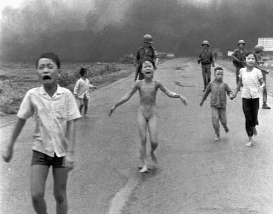 South Vietnamese soldiers escort terrified children after a napalm attack in June 1972.