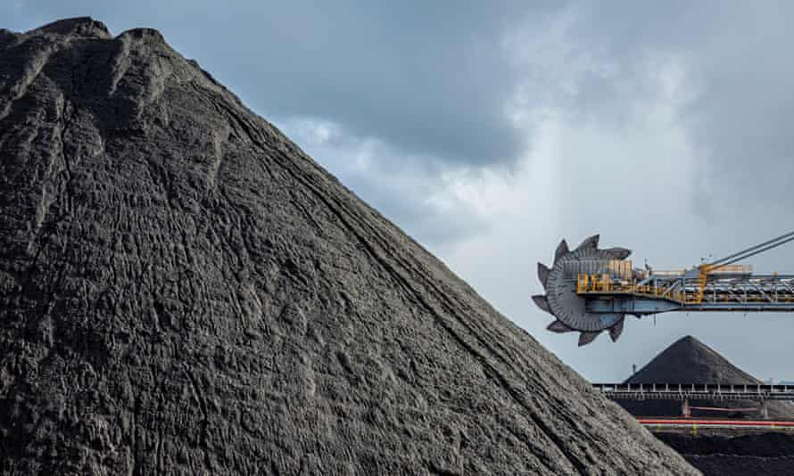An automated bucket-wheel excavator loads coal into ships bound for China and India.
