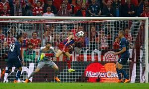 Robert Lewandowski scores Bayern Munich's third goal in the Champions League quarter-final second leg against Porto.