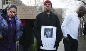 Donald Lightfoot holds a sign in support of Rekia Boyd while joining other protesters in Chicago on Monday.