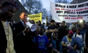 Maryland state delegate Keith E Haynes, speaks to the crowd outside of the Baltimore West District police station during a rally for Freddie Gray on Tuesday night.