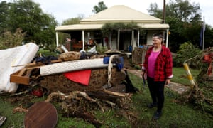 Mary O'Dell surveys the damage to her house caused by flooding in Stroud.