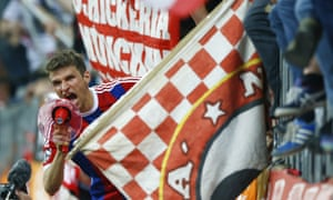 Bayern's Thomas Müller celebrates with fans after the game.