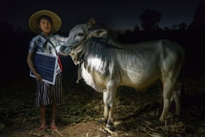 Mg Ko, 20 years old. A Shan farmer with his cow in Lui Pan Sone village, Kayah State Winner, portraiture