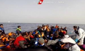 Italian coast guard personnel rescue shipwrecked migrants off the coast of Sicily