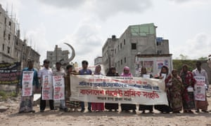 Relatives and former Rana Plaza workers demand their compensation in front of the site of the tragedy in Savar, near Dhaka, Bangladesh.