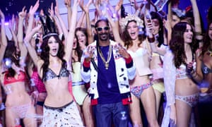 'It's always a party': Snoop Dogg with models on the catwalk during Paris fashion week, March 2015.