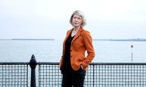 'I always feel better when I put this on': Sarah Smith in her 'Lib Dem orange' jacket by the sea at Dover.