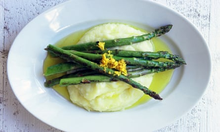 Asparagus spears with a grating of lemon zest, lying across mashed potato