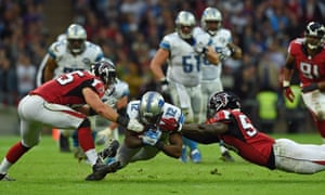 Detroit Lions wide receiver Jeremy Ross (12), centre, makes a down during the NFL football game against Atlanta Falcons at Wembley Stadium, London, Sunday, Oct. 26, 2014.  (AP Photo/Tim Ireland)NFLACTION13;