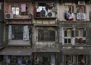 A resident sits on a balcony of an apartment