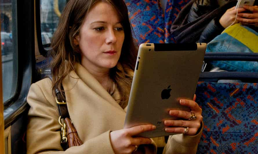 A woman reading a kindle