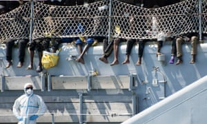Migrants wait to disembark from an Italian navy ship in Salerno. Theresa May and Philip Hammond believe such rescue operations create a 'pull factor' and lead to more deaths by encouraging migrants to risk the dangerous sea crossing.