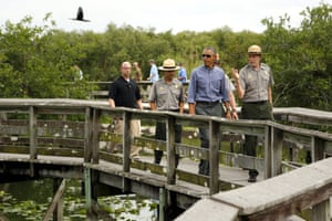 President Barack Obama takes a walking tour of the Anhinga Trail at Everglades National Park, Florida as part of a push to get Americans thinking and talking about the damage climate change is causing.