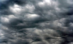 Dark clouds before rain.  New research shows that clouds and water vapor are amplifying global warming.