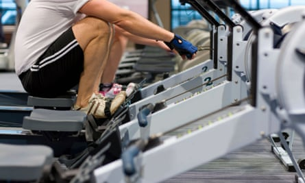 Man working out on rowing machine.