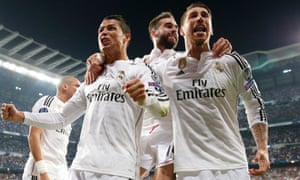 Sergio Ramos, right, and his Real Madrid team-mates celebrate after Javier Hernández scored the winner against Atlético.