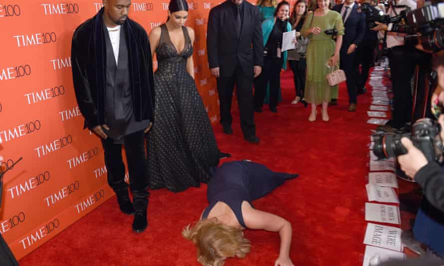 Amy Schumer prostrates herself in front of an unimpressed Kim Kardashian and Kanye West.