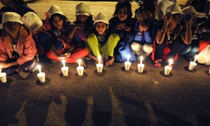 Children in New Delhi take part in a candlelit vigil to end child slavery in November 2014. An estimated 135,000 children are trafficked in India annually.