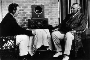 Holmes service … Sir Arthur Conan Doyle, right, and a friend listen to a radio in 1922.