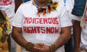 indigenous woman wears a tshirt calling for land rights