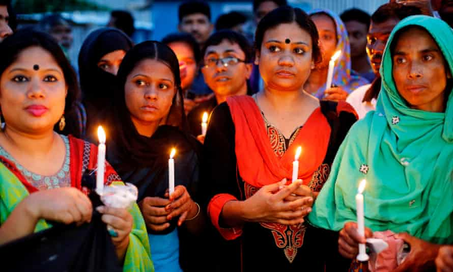 Relatives and activists attend a candlelight vigil