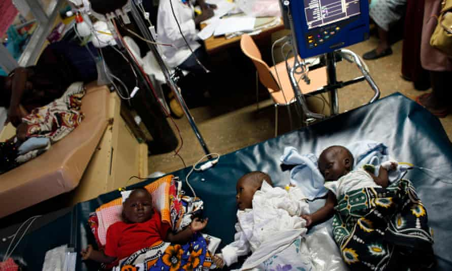 Three babies with severe malaria receive a blood transfusion in the Siaya hospital in western Kenya.