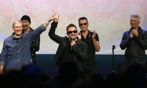 Apple CEO Tim Cook (L) with Bono and the rest of U2 as they unleash their album at the Apple launch event in 2014.