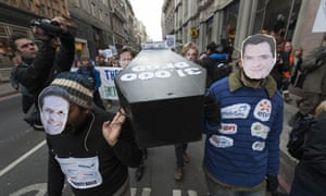Protesters in London with coffin