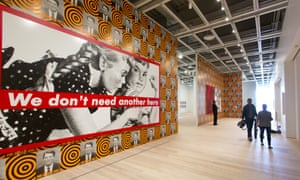 """Barbara Kruger's Untitled (We Don't Need Another Hero)"""" is displayed with David Moffett's He Kills Me at the Whitney Museum of American Art in New York"""