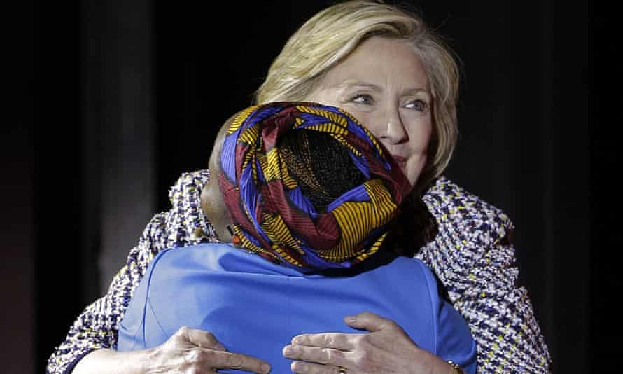 Hillary Clinton greets former aide Beatrice Biira at the Women in the World Summit in New York.