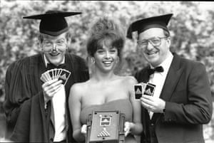 1987 Steve Davis and Dennis Taylor pose with model Maria Whittaker at the launch of a new quiz game called Matchroom
